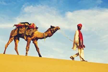 thar: Indigenous Indian man walking desert camel Concept