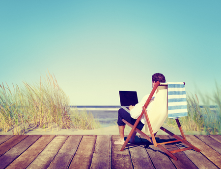 telecommuting: Businessman Working by the Beach Relaxation Concept