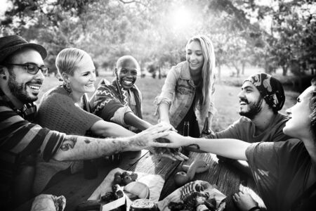 young adults: Friends Outdoors Camping Teamwork Unity Concept Stock Photo