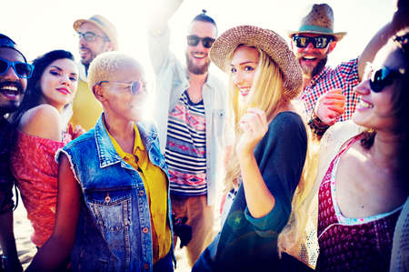 sunset beach: Teenagers Friends Beach Party Happiness Concept Stock Photo