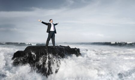 man standing alone: Businessman staying alone on the island. Stock Photo