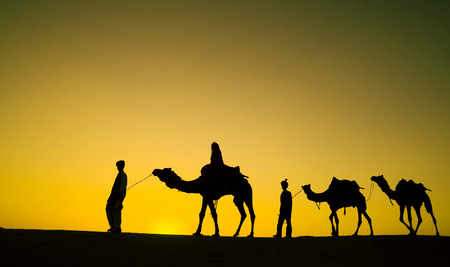 indigenous: Indigenous Indian Men Walking Through Desert Camel Concept Stock Photo