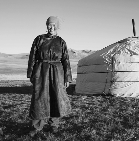 southeast asian ethnicity: Mongolian Woman Standing Tent Outdoors Tranquil Concept
