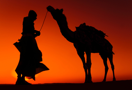thar: Indigenous Indian Man with His Camel Concept Stock Photo