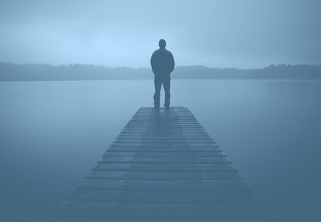 deliberation: Man Standing Jetty Tranquil Lake Gloomy Fog Dusk Concept