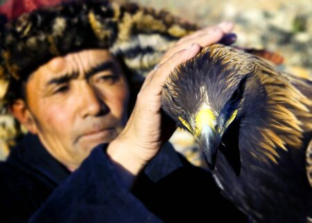 independent mongolia: Mongolian Man Trained Eagle Kazakh Olgei Western Concept