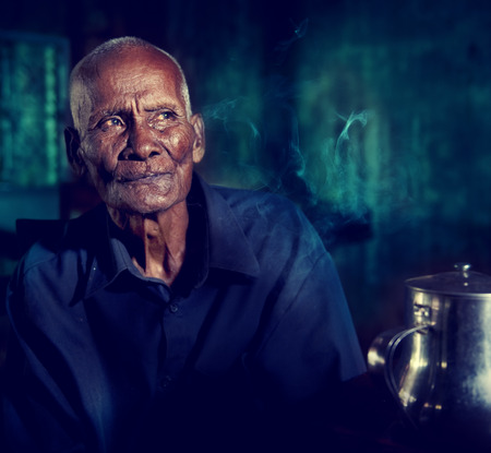 southeast asian ethnicity: An Old Tea house And A Man In It Cambodia Concept Stock Photo