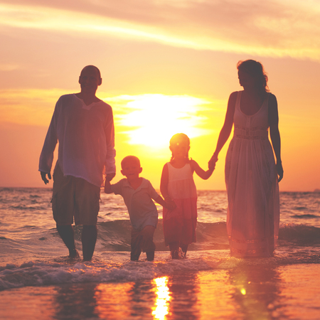 beach scene: Family Walking Beach Sunset Travel Holiday Concept Stock Photo