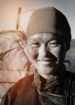 southeast asian ethnicity: Mongolian Woman Traditional Dress Lifestyle Concept Stock Photo