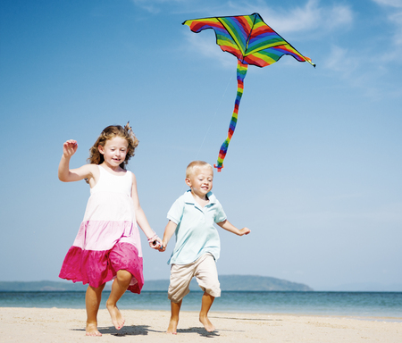 flying man: Children Playing Kite Happiness Cheerful Beach Summer Concept