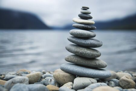 deliberation: Zen Balancing Pebbles Misty Lake Stone Stack Tranquil Concept