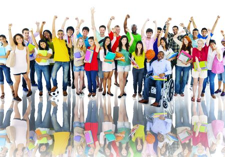 group shot: Diverse High School Students Arms Raised Concept Stock Photo