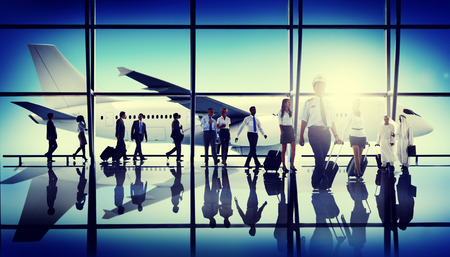 business phone: Business People Traveling Airplane Airport Concept Stock Photo