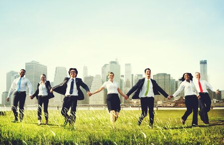 hand: Business People Holding Hands Together Outdoors Concept Stock Photo