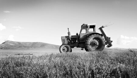 suburb: Tractor Agriculture Tranquil Remote Suburb Field Concept