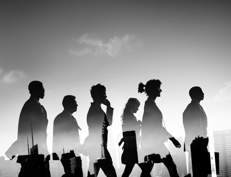 rushing hour: Silhouette Business People Commuter Walking Rush Hour Concept Stock Photo