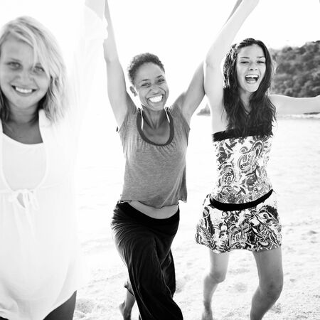 best travel destinations: Women Fun Beach Girls Power Celebration Concept Stock Photo