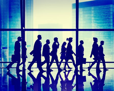 rushing hour: Silhouette Group of People Walking Concept Stock Photo