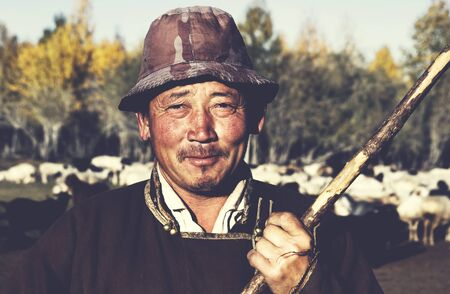 independent mongolia: Portrait of Mongolian Man Farmer Worker Concept Stock Photo