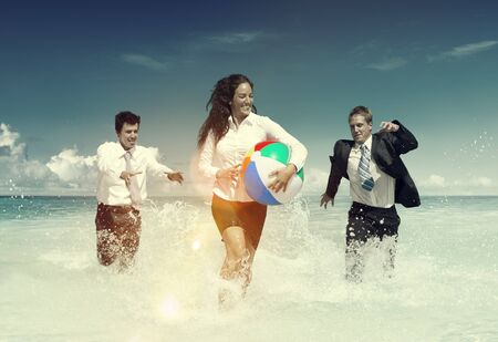 winning location: Business People Fun Playing Beach Travel Concept