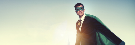 leadership: Superhero Businessman Cityscape Leadership Concept