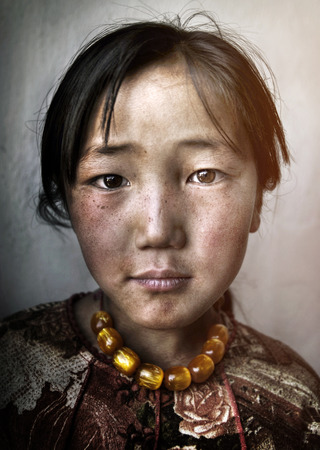 poor child: Mongolian Girl Portrait Innocent Culture Poverty Concept Stock Photo