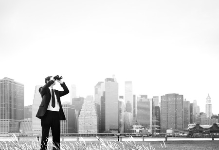 man searching: Business Man Searching Binoculars Outdoors Concept