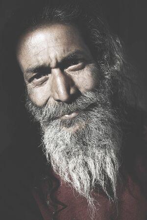 grumpy old man: Indigenous Senior Indian Man Looking Camera Concept