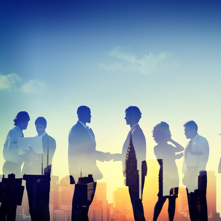 introduction: Back Lit Business People Communication Greeting Handshake Concept Stock Photo