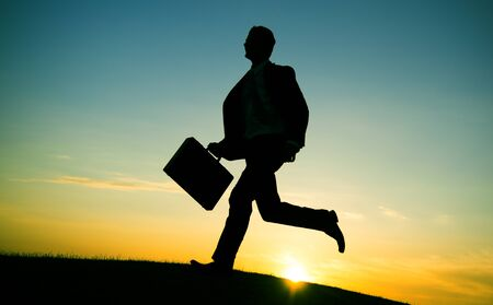rushing hour: Businessman Running Up Hill Occupation Mission Aim Concept Stock Photo