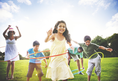 outdoor activities: Family Hula Hooping Relaxing Outdoors Concept Stock Photo