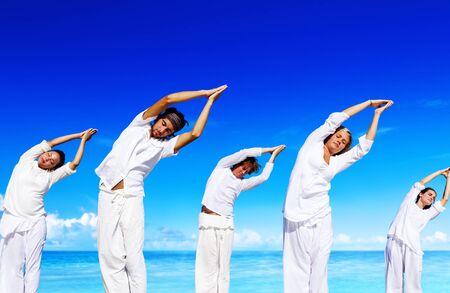 yoga beach: People Healthy Yoga Beach Vacation Relax Concept Stock Photo