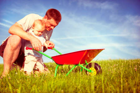 english ethnicity: Father and Son Playing Together Happiness Concept Stock Photo