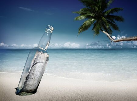 message bottle: Message Bottle Beach Sending Information Letter Concept Stock Photo