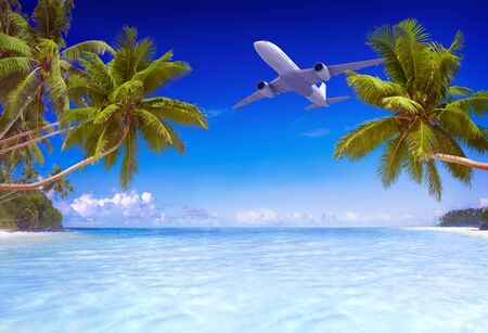 tropical paradise: Airplane Flying Over Tropical Beach Travel Concept Stock Photo