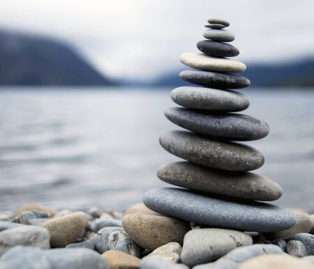 rocks water: Zen Balancing Pebbles Misty Lake Abstract Peaceful Concept