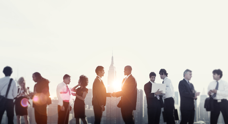 people shaking hands: Business People Shaking Hands Rooftop City Concept