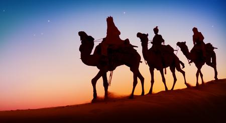 men back: Three Wise Men Camel Travel Desert Bethlehem Concept Stock Photo