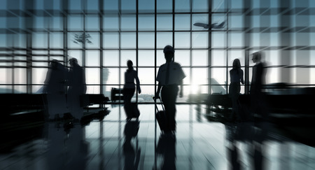 airport terminal: Back Lit Business People Traveling Airport Concept Stock Photo