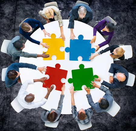 organizing: Business People Jigsaw Puzzle Collaboration Team Concept