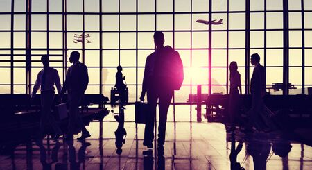 backlit: Back Lit Business People Traveling Airport Passenger Concept