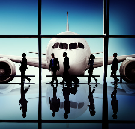 flight mode: Back Lit Business People Traveling Airplane Airport Concept