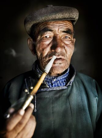 independent mongolia: Mongolian Traditional Dress Smoking Pipe Solitude Concept