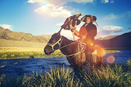 independent mongolia: Kazakh Trained Eagle Equestrian Olgei Mongolia Concept