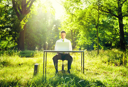 green man: Businessman Working Computer Forest Green Concept Stock Photo