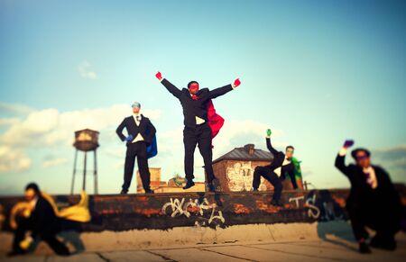 fuerza: Superhero Business People Fuerza Paisaje urbano Equipo Concepto Foto de archivo