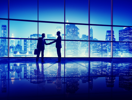 city in the night: Business People Handshake Silhouette Concept Stock Photo