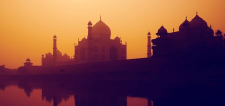 subcontinent: Sunset Silhouette Of A Grand Taj Mahal Sunset Concept Stock Photo