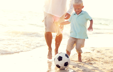 away from it all: Father Son Playing Soccer Beach Summer Concept