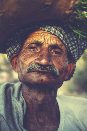 old man portrait: Indigenous Senior Indian Man Grumpy Camera Concept